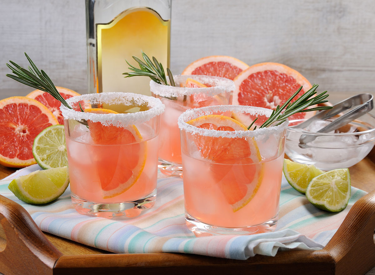 paloma cocktail grapefruit fruit garnish in glass on tray