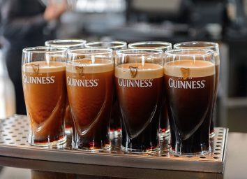 8 poured guinness in 8 glasses