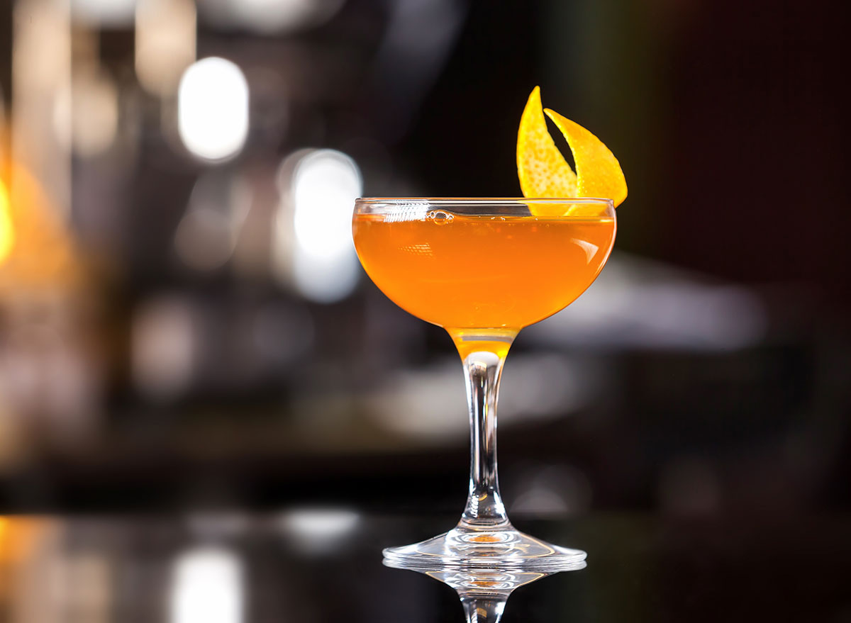 sidecar cocktail in tall fishbowl glass