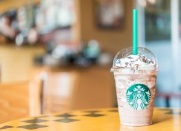 starbucks frappuccino on table with green straw