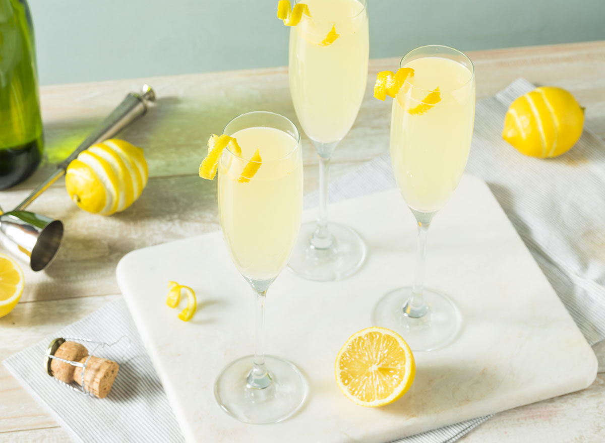 the french 75 cocktail in champagne glasses