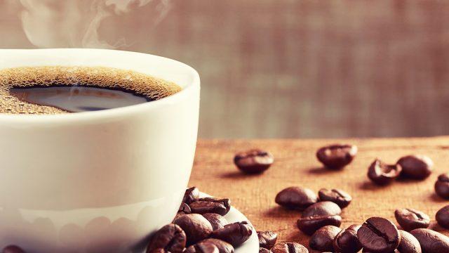 mug of coffee with beans
