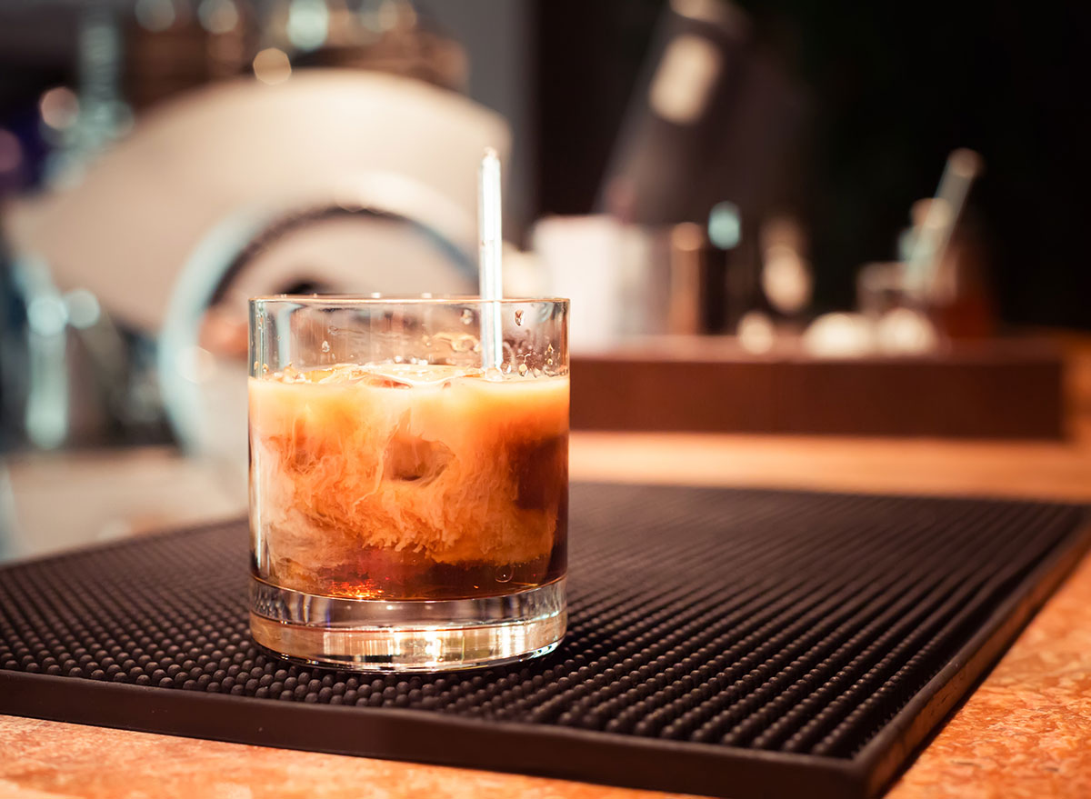 white russian stirred in glass on bar