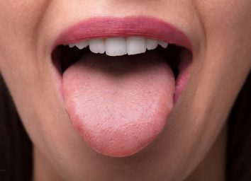 Woman sticking tongue out of mouth