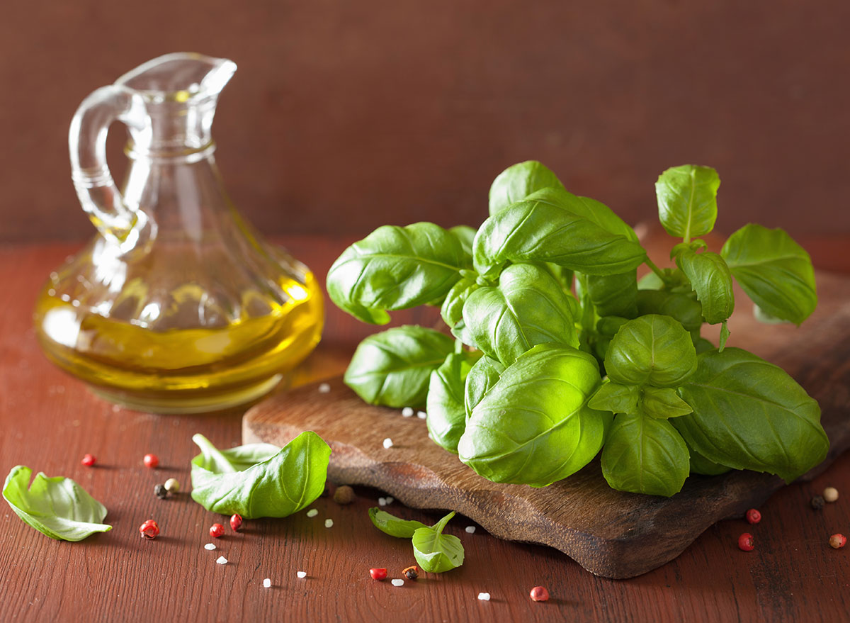 basil with olive oil on serving platter