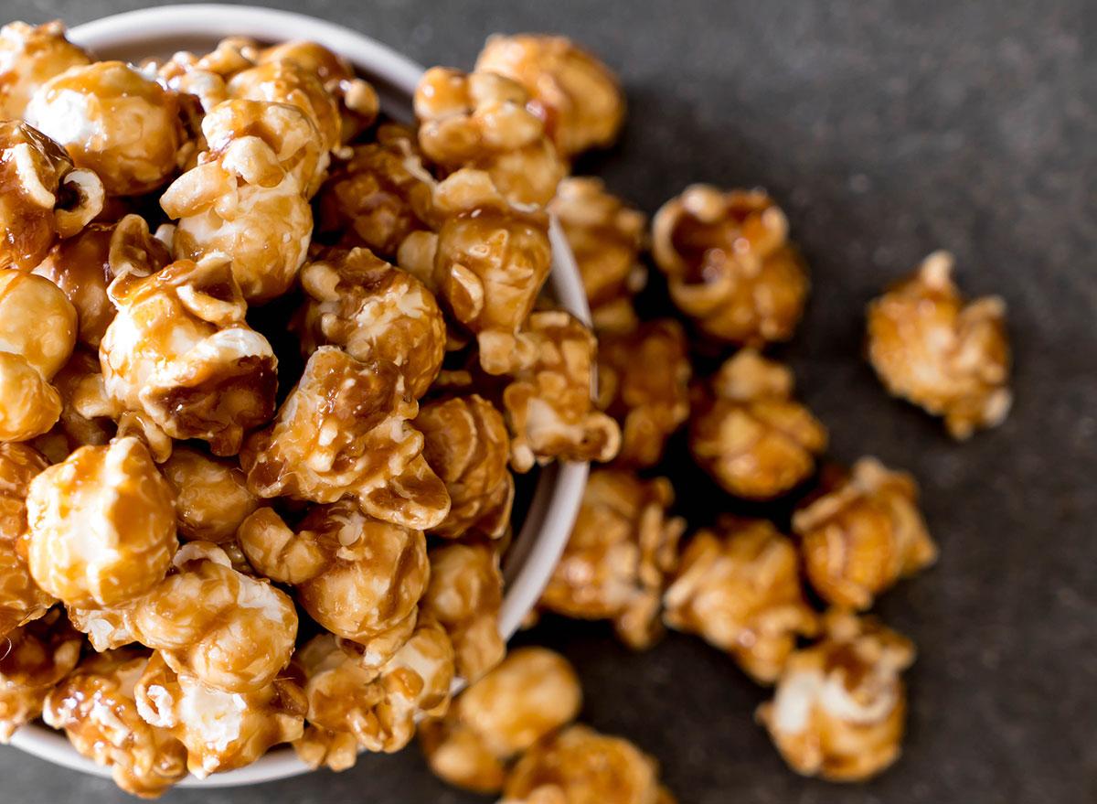 caramel popcorn in bowl spilling