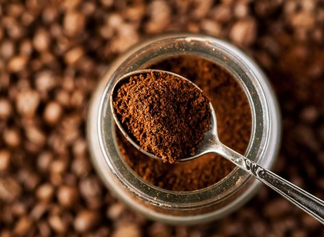 coffee grounds on spoon from jar