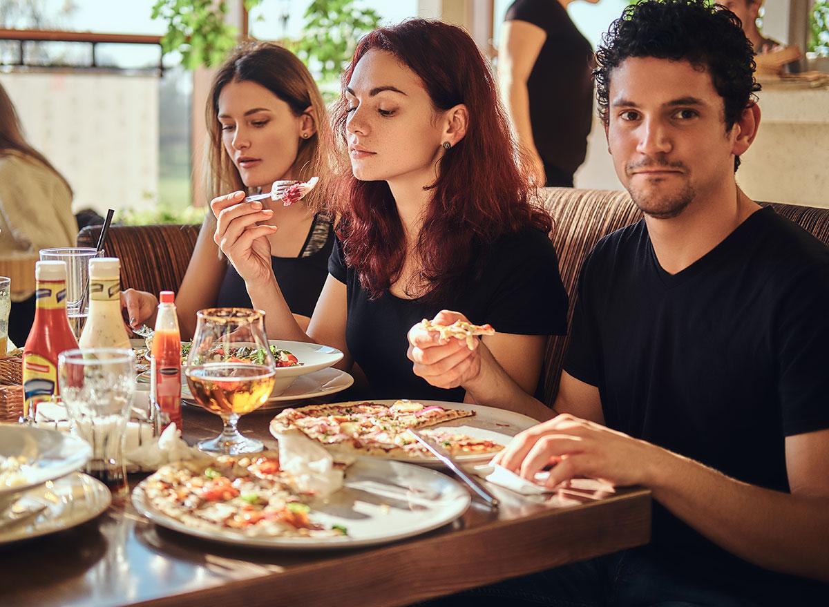 friends eating at italian restaurant