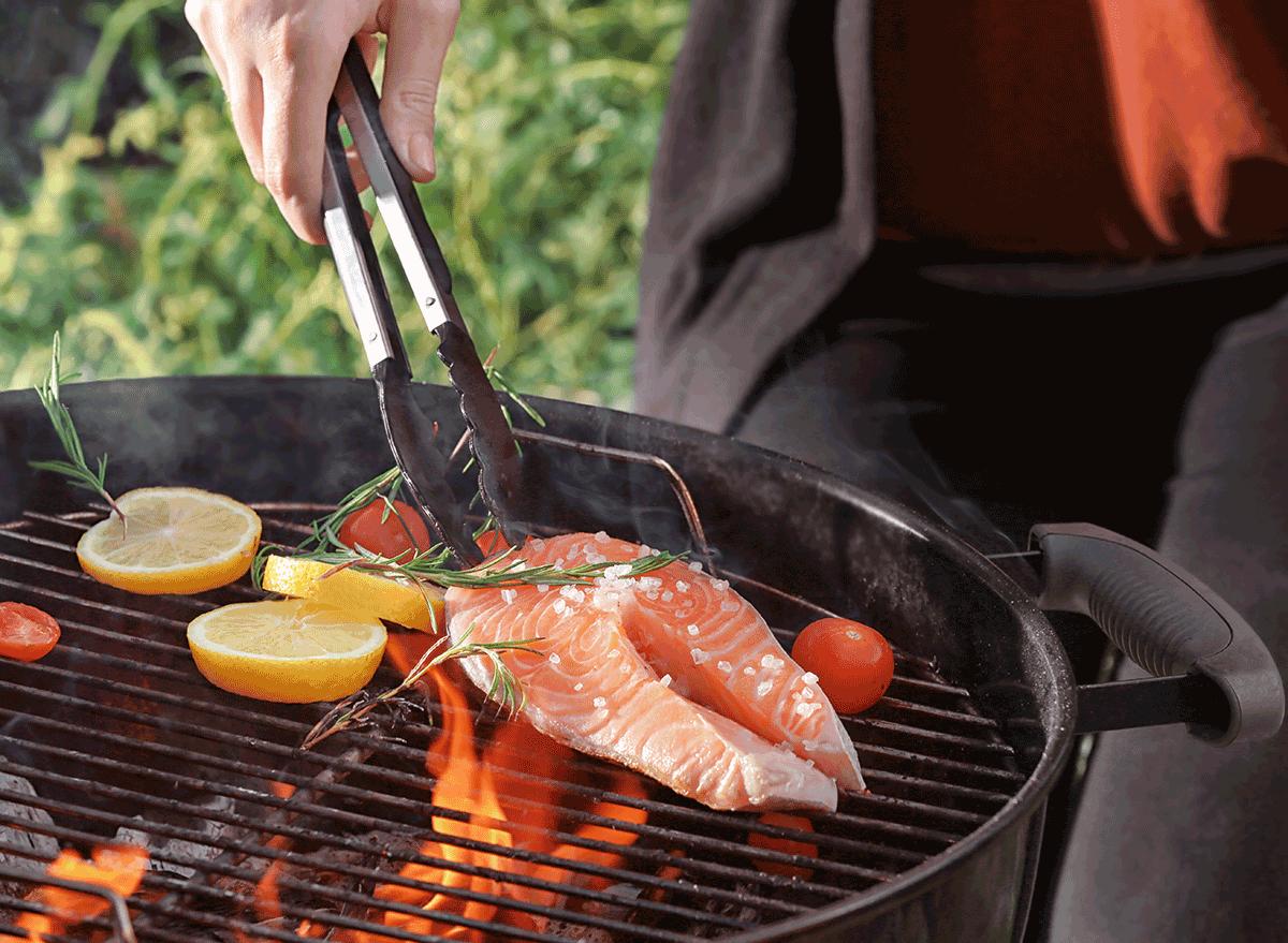 tongs grilling salmon