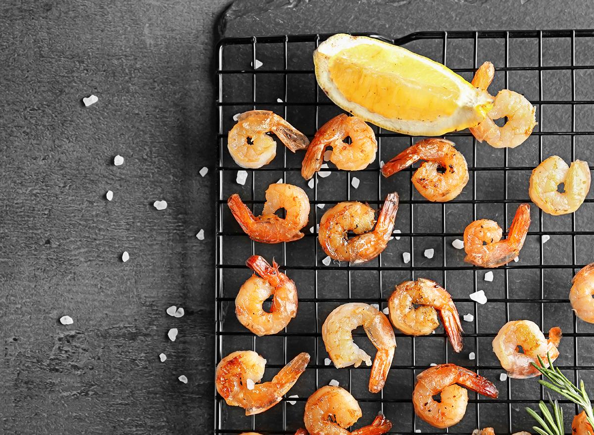 grilled shrimp on cooling rack with lemon wedge and sea salt