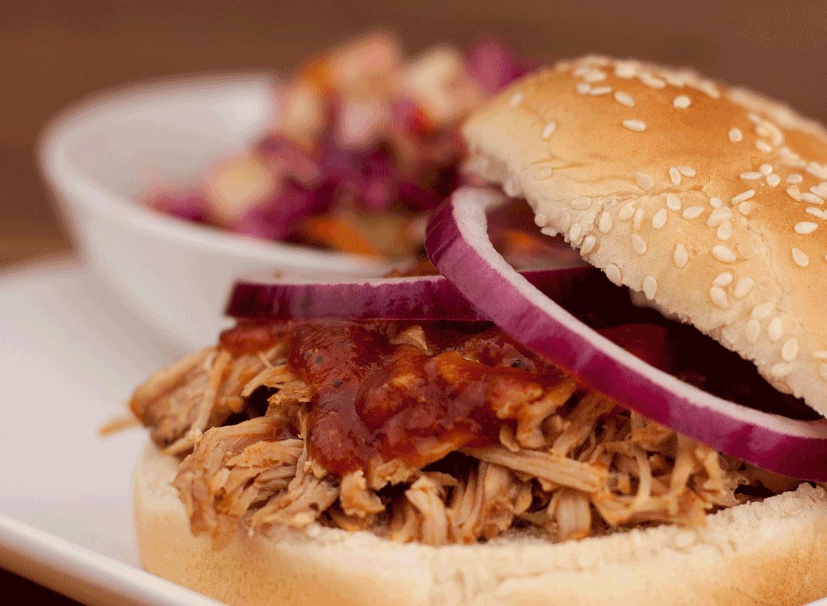 north carolina bbq sandwich with sauce onions on plate