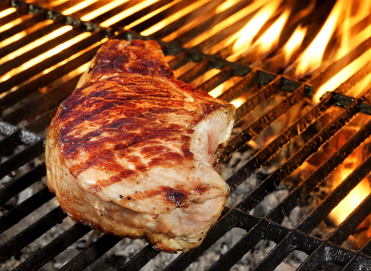 pork chops cooking on grill