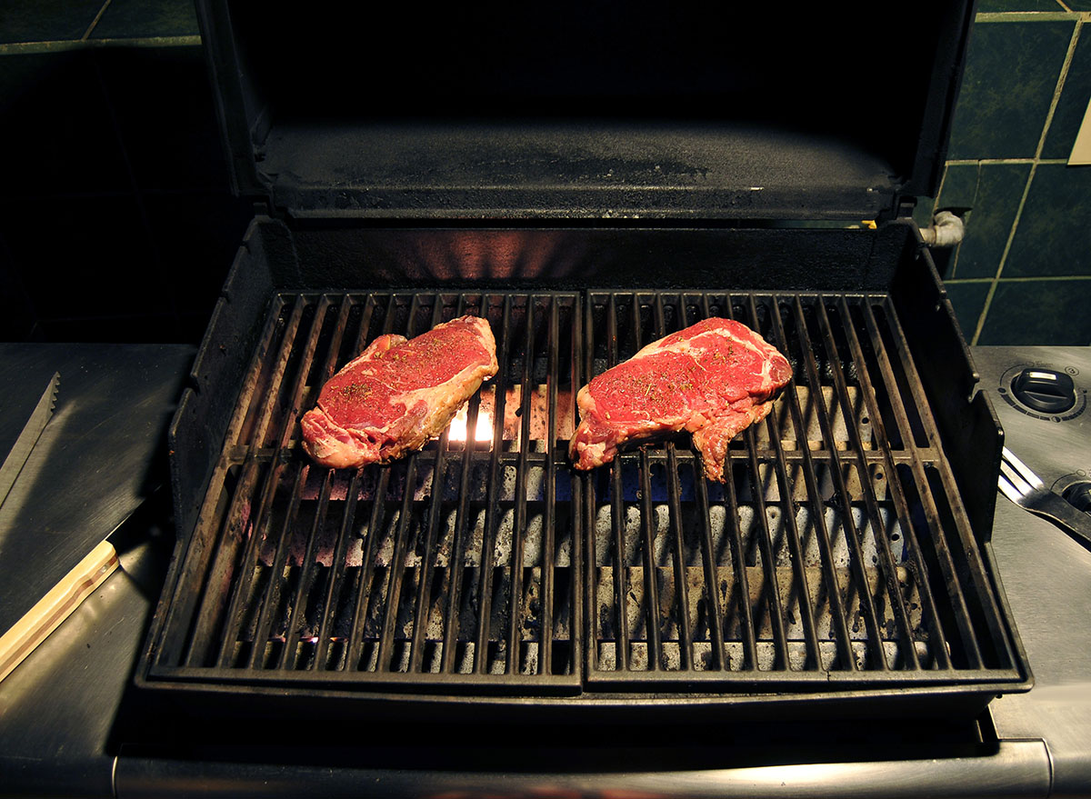 raw meat on grill