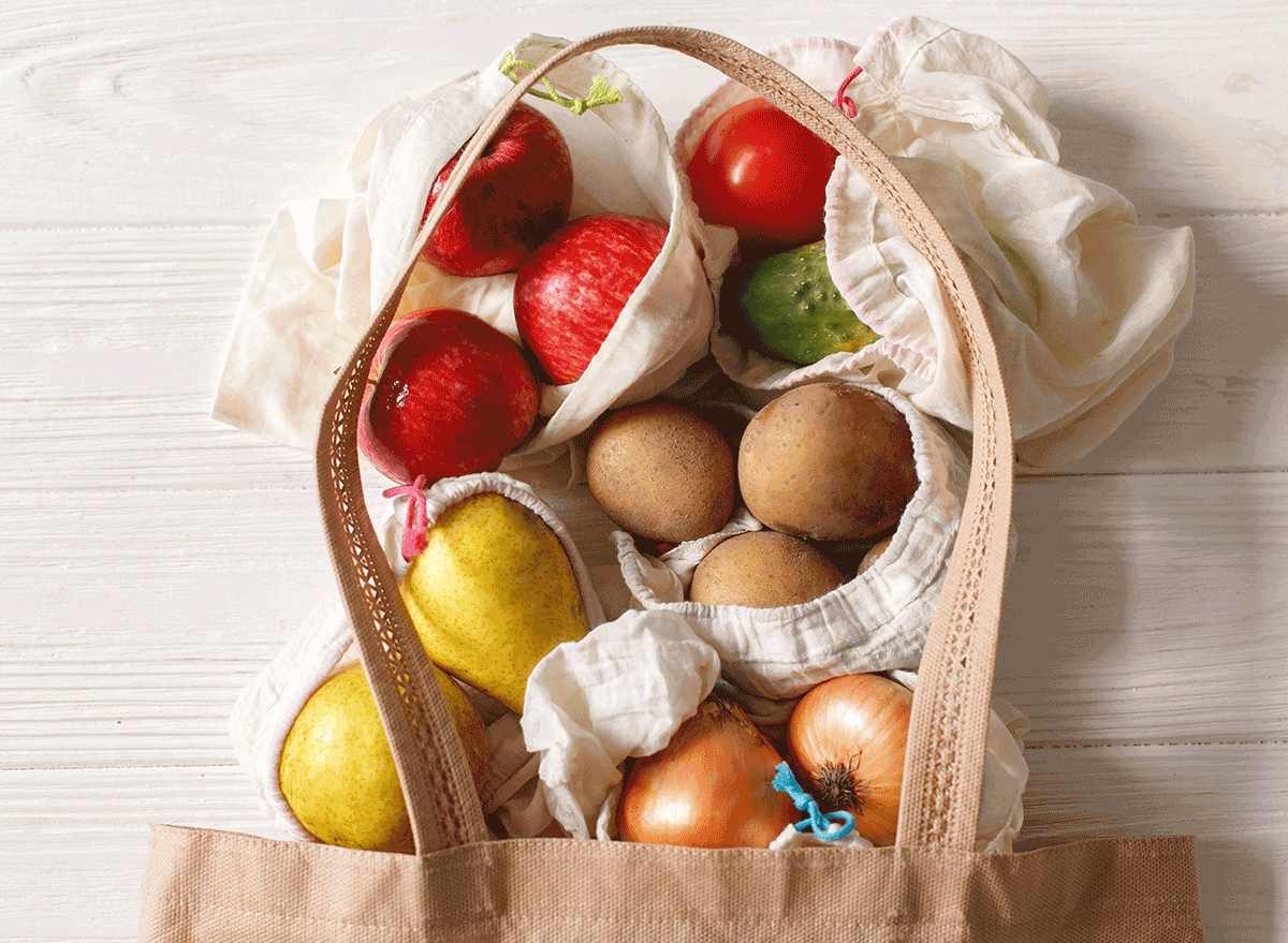 reusable grocery bag with fruits veggies spilling out