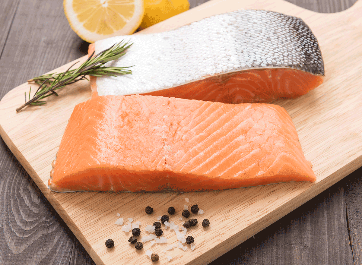 salmon fillets on cutting board with skin - muscle building foods