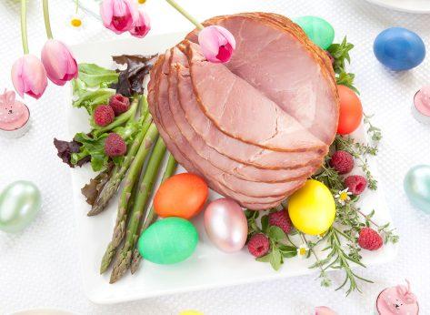 sliced easter table ham on serving plate