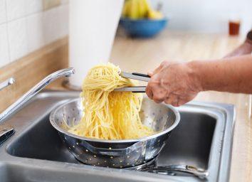 straining pasta in sink