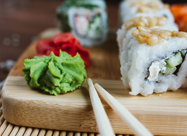 wasabi and sushi on wooden board