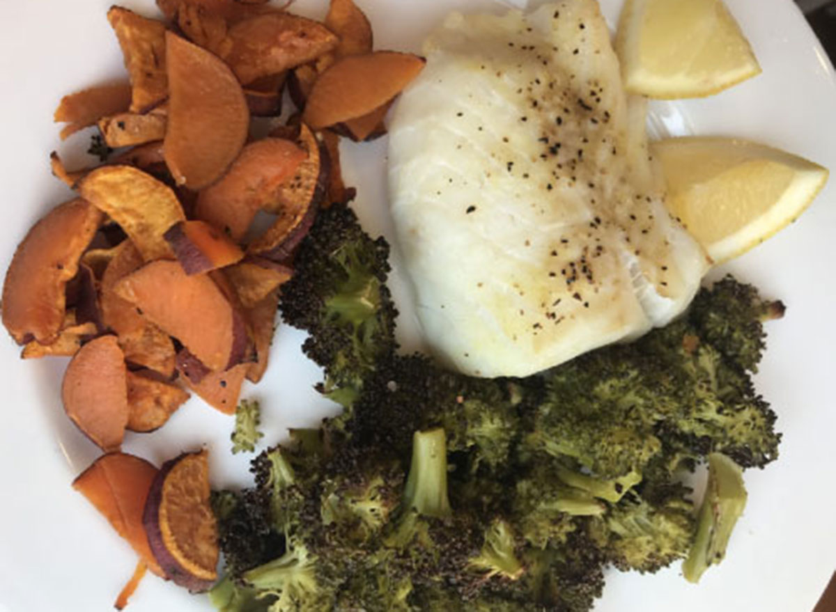 piece of cod roasted side sweet potato discs broccoli - what a peloton instructor eats