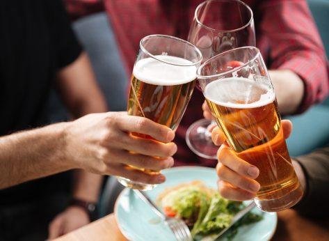 People clinking beers