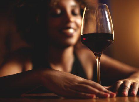 Black woman drinking red wine