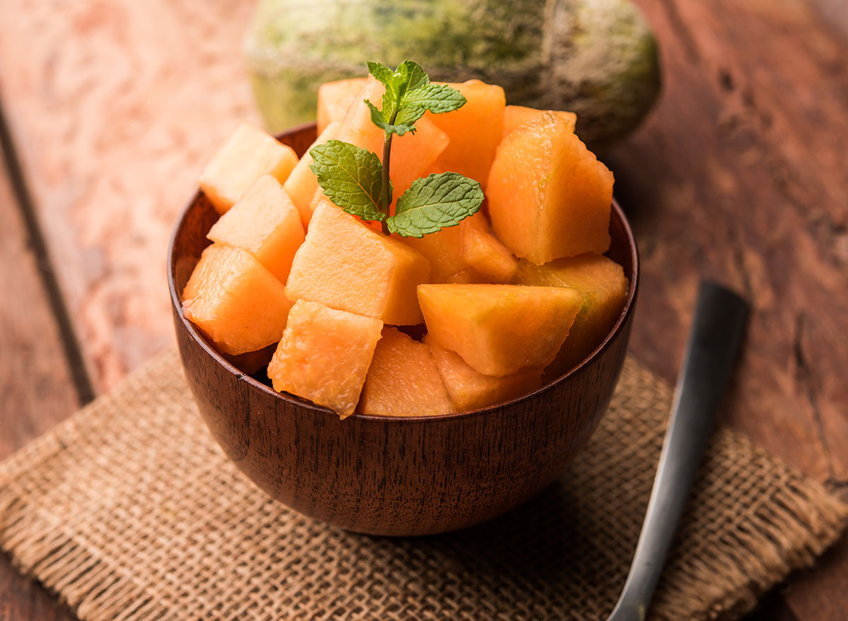 wooden bowl of sliced cantaloupe