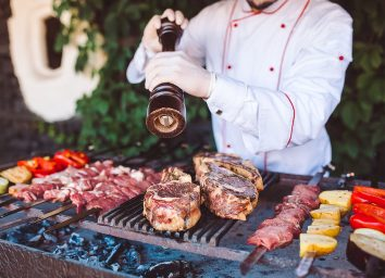 chef grilling meat and vegetables