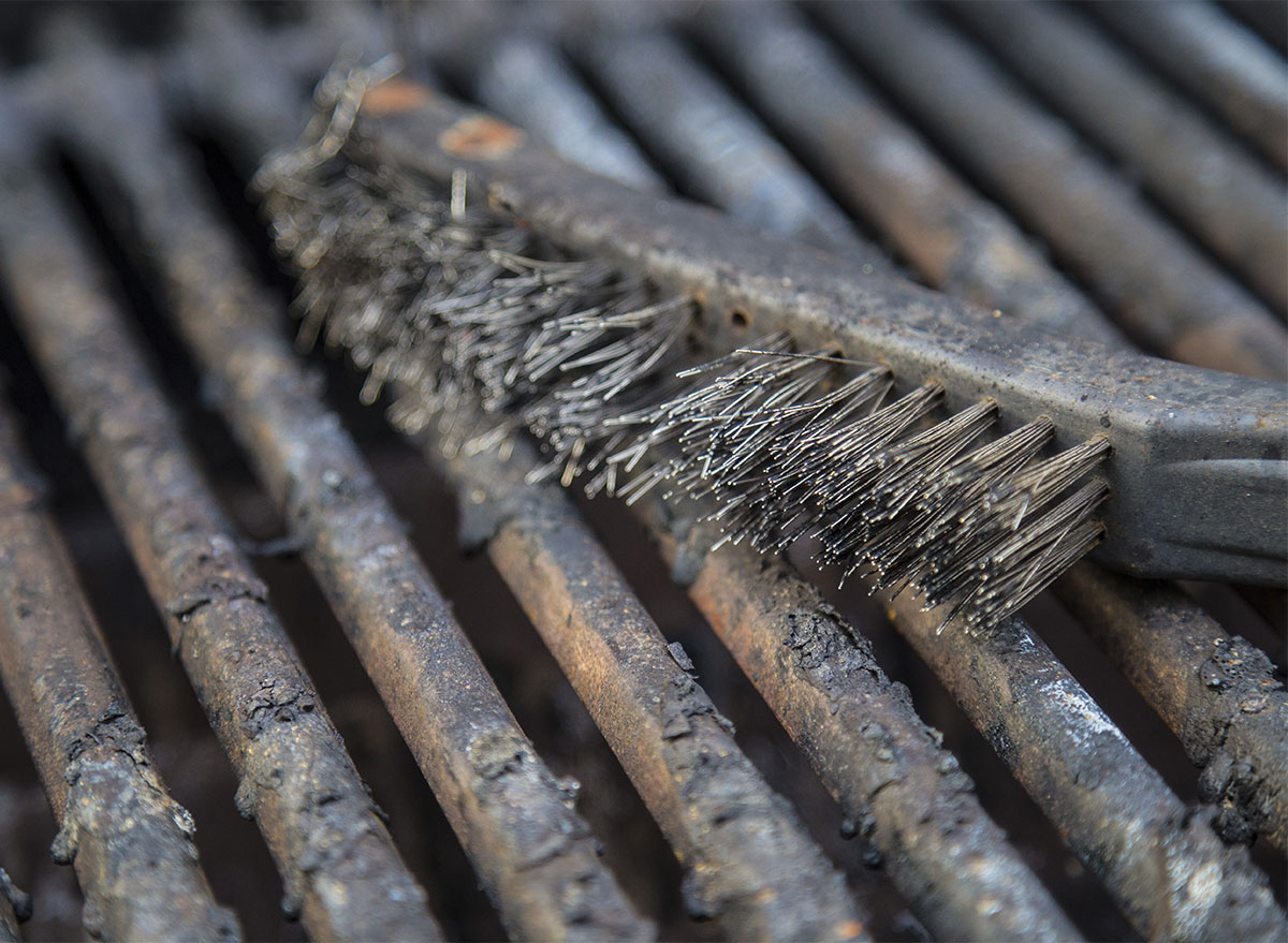 grill brush on dirty grill grates