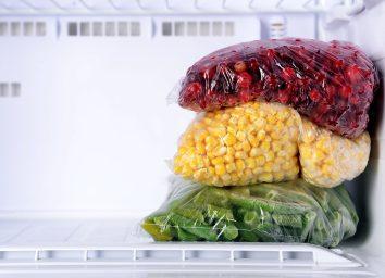 frozen cranberries corn and green beans in an empty freezer