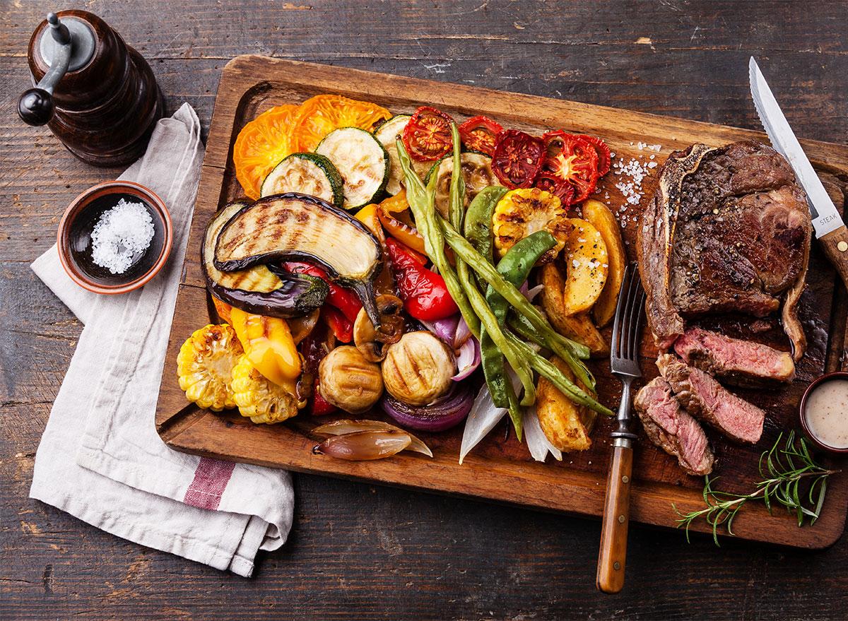 serving platter of grilled steak and vegetables