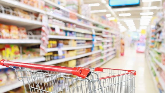grocery cart in aisle with blurred background