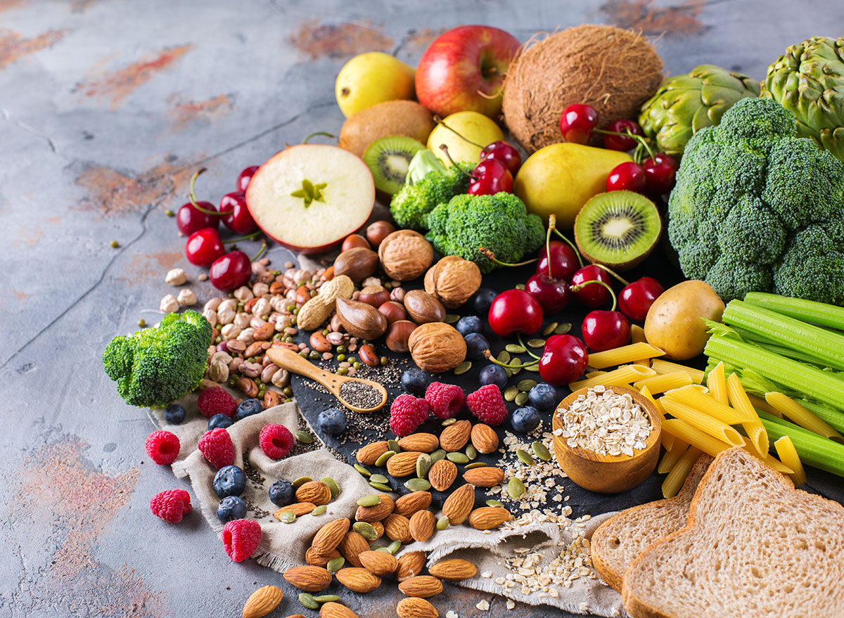a spread of various vegetables, fruits, nuts and oats