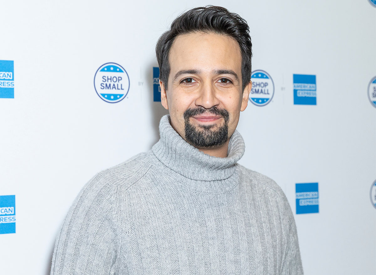 lin manuel miranda on step and repeat in gray turtleneck