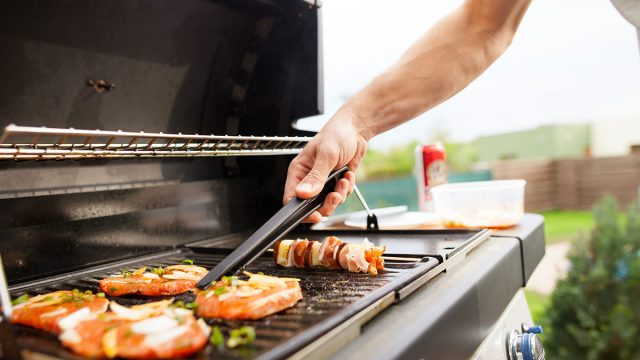 man grilling food outside
