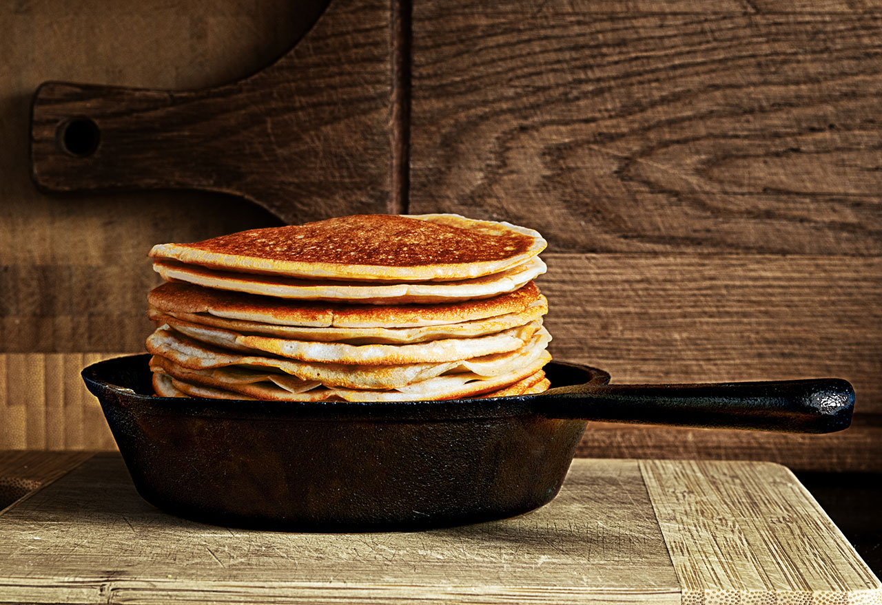stack of pancakes in cast iron skillet