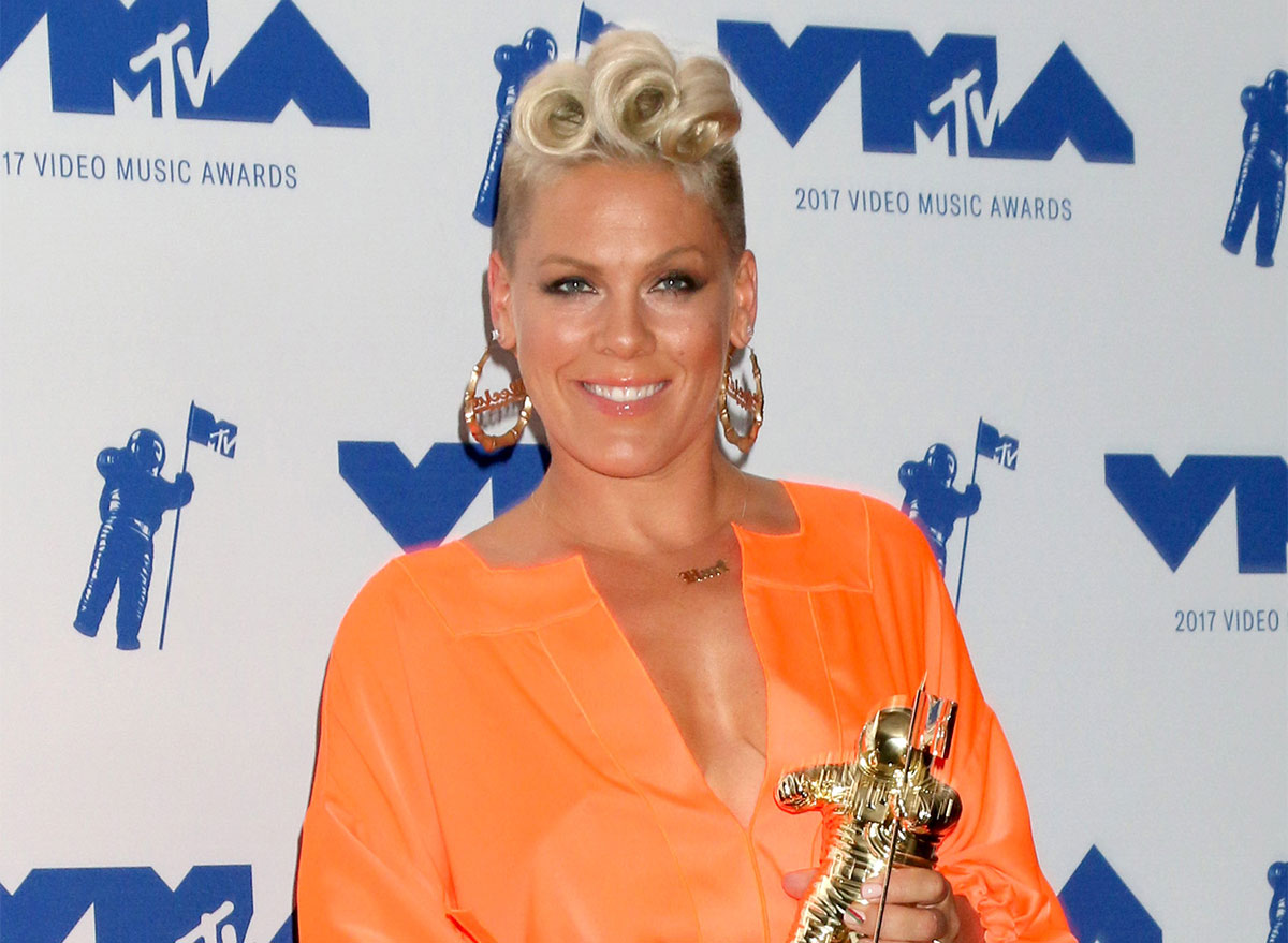 pink with grammy award on red carpet