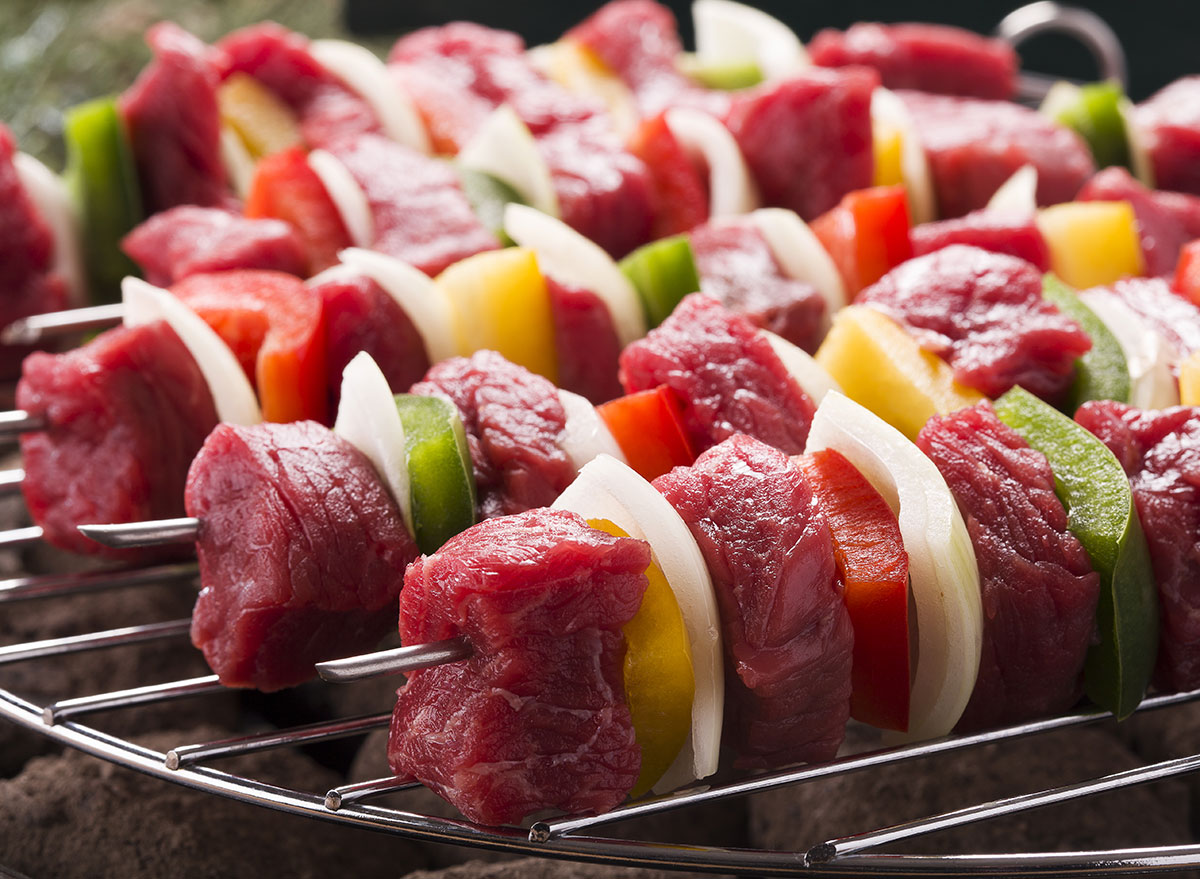 raw meat kebab close to vegetables