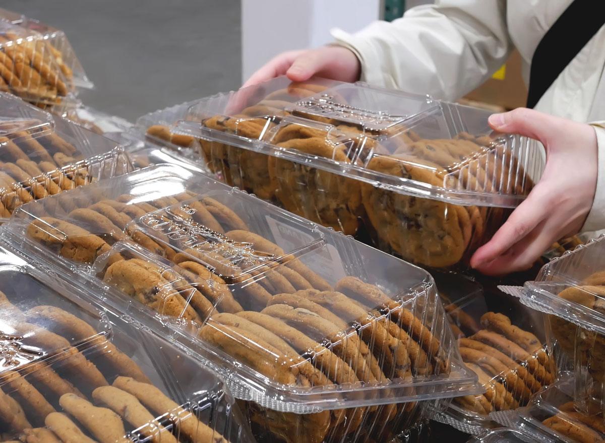 Man grabbing multi pack bulk of cookies from costco