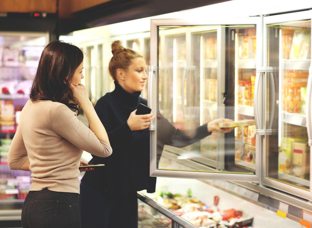 Women buying frozen food