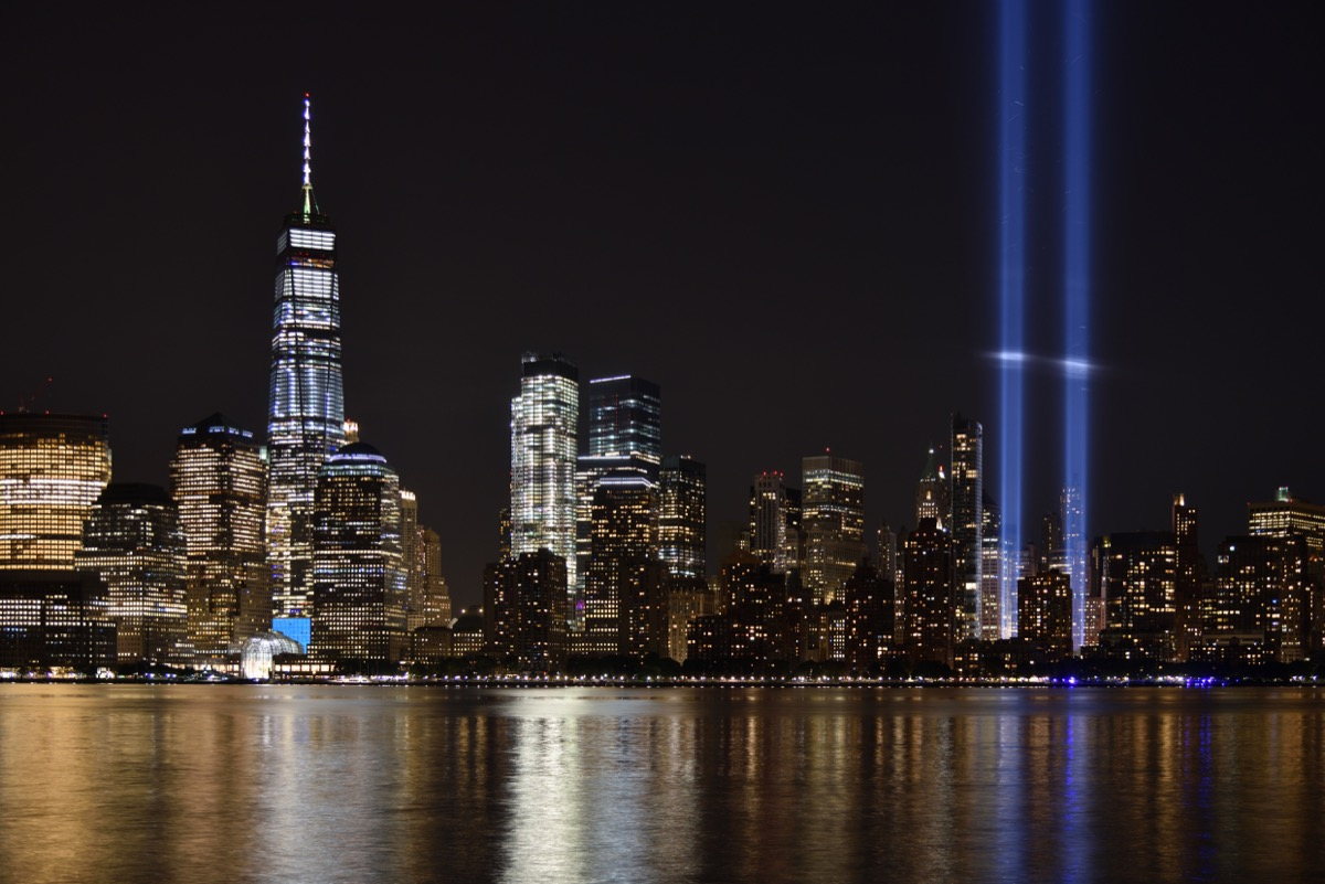 The 9/11 Tribute in Lights temporary monument in lower Manhattan dominates the city skyline