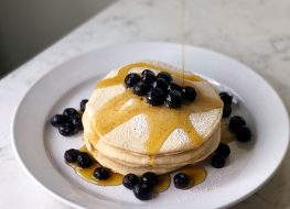 banana pancake with cottage cheese blueberries and syrup