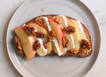 apple brie walnut maple syrup toast on marble counter