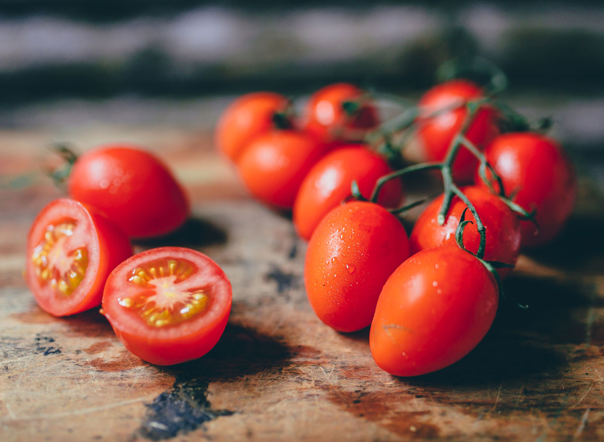 Cherry tomatoes on wooden cutting board
