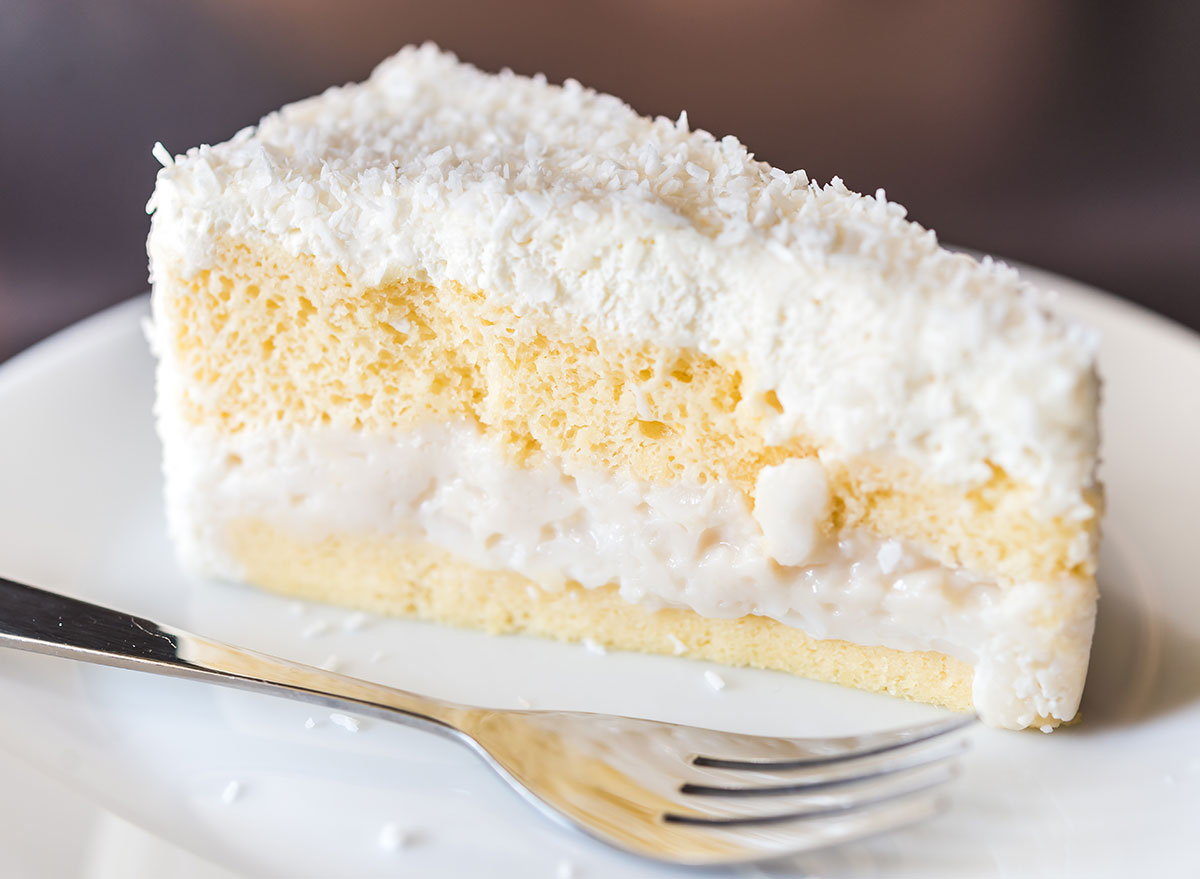slice of coconut cake with fork