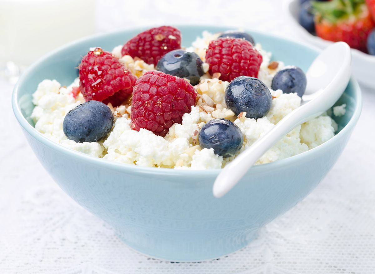 cottage cheese breakfast bowl with blueberries raspberries and nuts