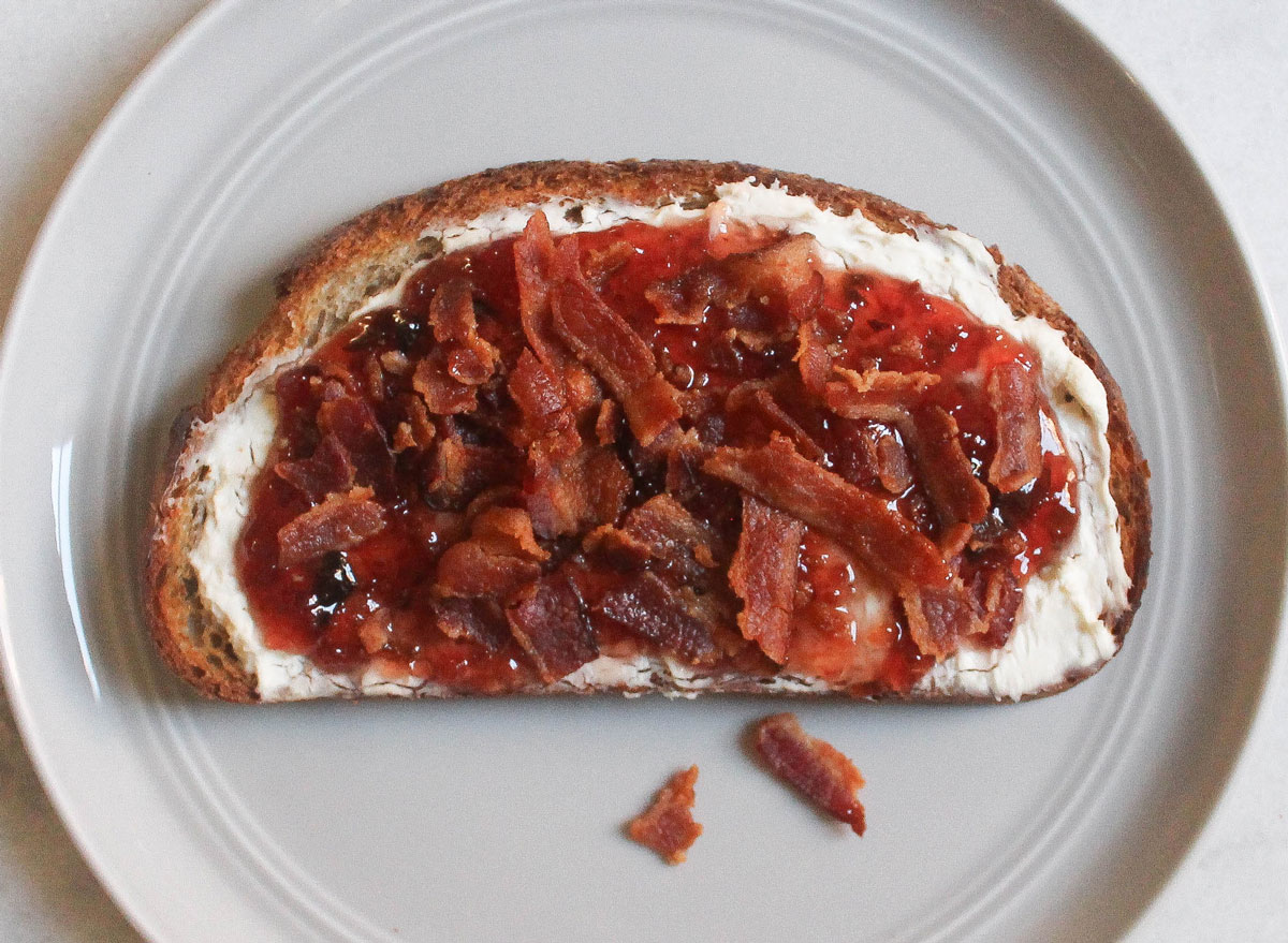 cream cheese hot pepper jam bacon toast on grey plate and marble counter