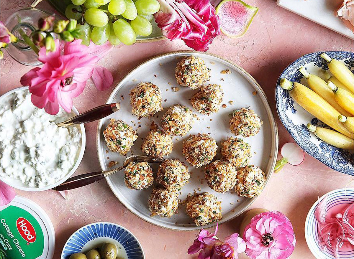 herbed cheese bites with cottage cheese on a pink table with fruit