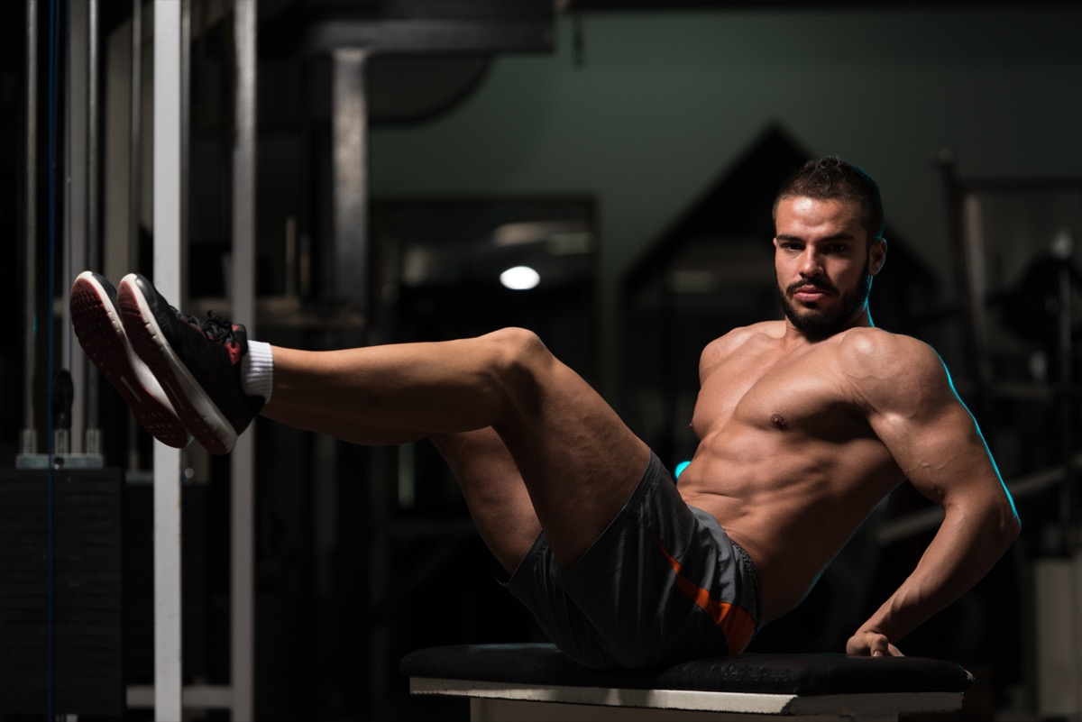 Exercising Abs On Bench Plank Hip Raise Abdominal Crunch In Fitness Club