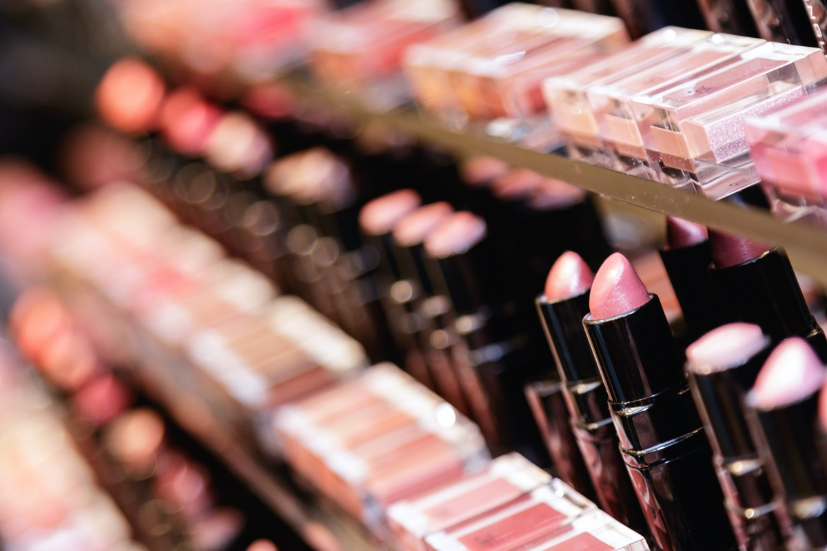 Testers of different lipsticks in the cosmetic store.