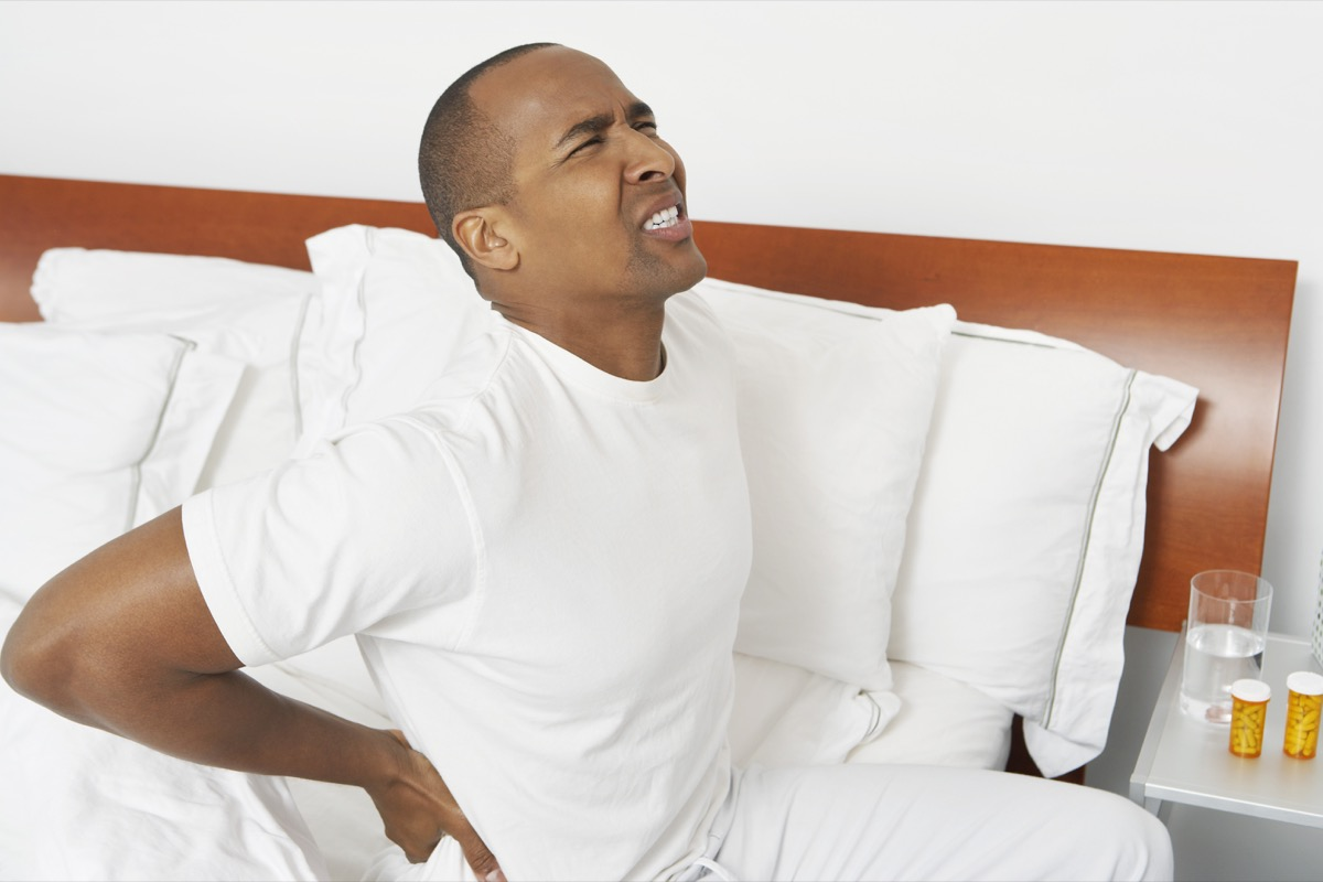 man with severe backache sitting